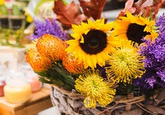 Sunflowers mixed with orange, purple and yellow accent flowers