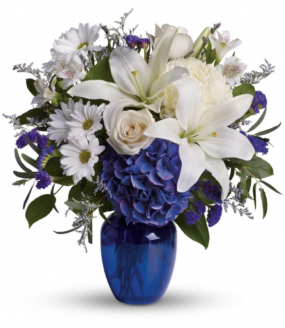 White lilies and roses and blue hydrangeas in a cobalt blue vase  sc 1 st  Kalamazoo Florist & Beautiful in Blue - White Flowers \u0026 Blue Vase | VanderSalm\u0027s Florist