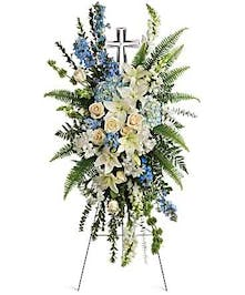 blue and white easel with cross