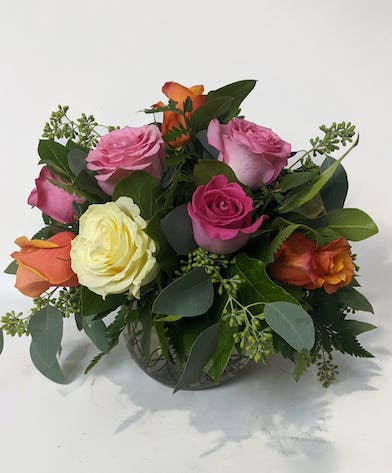 colorful roses in a compact bubble bowl with eucalyptus