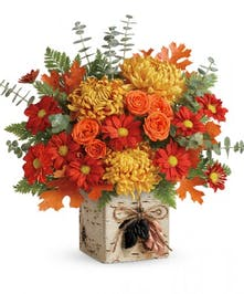 Fresh Fall Arrangement in a Seasonal Autumnal Container.